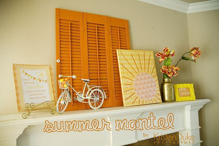 DIY summer mantle using orange and yellow home accents. Free printable, bicycle and shutter decorate the space.