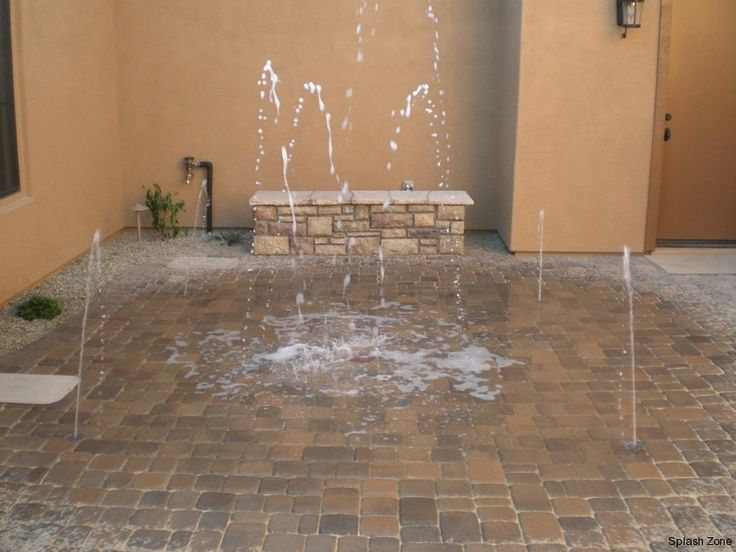 Private backyard splash pad - Didn't we used to just turn on the sprinklers and run across the lawn?