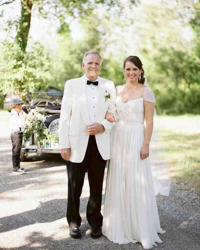 The blushing bride and her father were all smiles as they shared a special moment together.