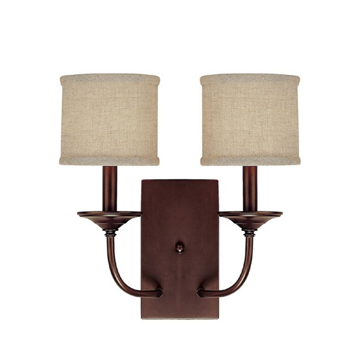 This Loft collection 2-light wall sconce features a burnished bronze finish that will compliment many loft, urban and transitional decors. The decorative beige fabric shades soften the light and complete the look.