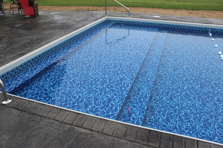 Vinyl Liner Swimming Pool With Sun Deck and Full Width Steps. Raft ...