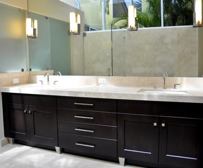 This sleek bathroom design inspires a calm, spa-like feel with its clean lines and soft lighting.