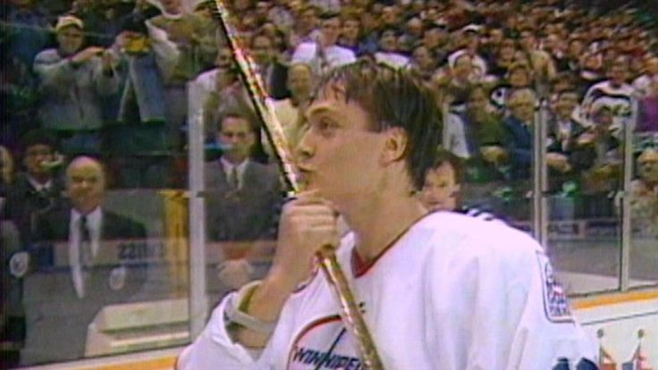 Selanne breaks the NHL record for goals by a rookie, passing Mike Bossy, by scoring three times for the Winnipeg Jets.