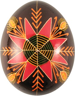Pysanka with Star Rose motif which symbolizes Christ and Gods love for man, and with Wheat motif which symbolizes a bountiful harvest. Red represents happiness and hope, Gold represnts spirituality and wisdom, and Black represents eternity.
