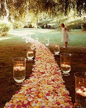 Loved this idea! Floating candles in vases to usher people to the ceremony.