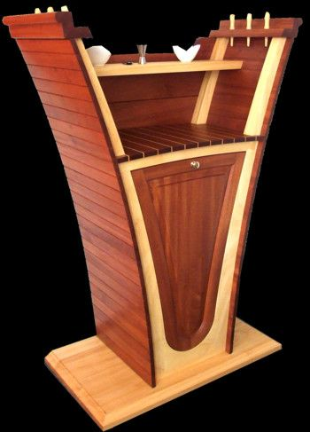 Yacht style bar cabinet by rubyn. The mahogany, solid wood, bar cabinet is not an everyday part in a yacht design. It shapes a prow and makes the bar unique this way. www.rubyn.eu