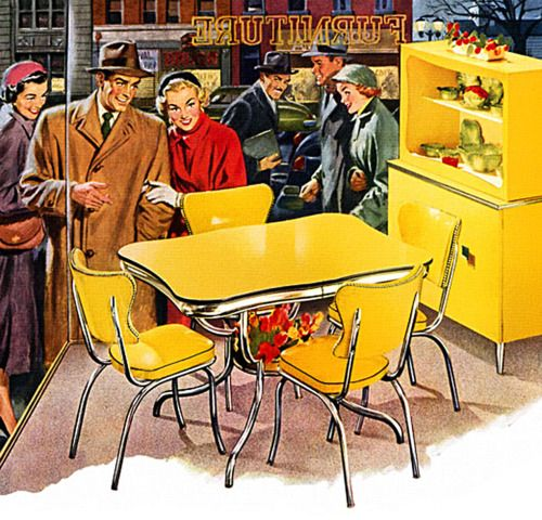 mid-century kitchen set in bright yellow. notice how artificial flowers are displayed under the table!