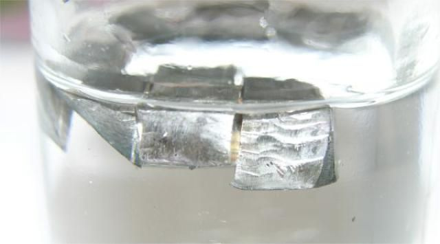 Everything You Need to Know About the Element Lithium: This is a photograph of lithium metal in liquid paraffin oil.
