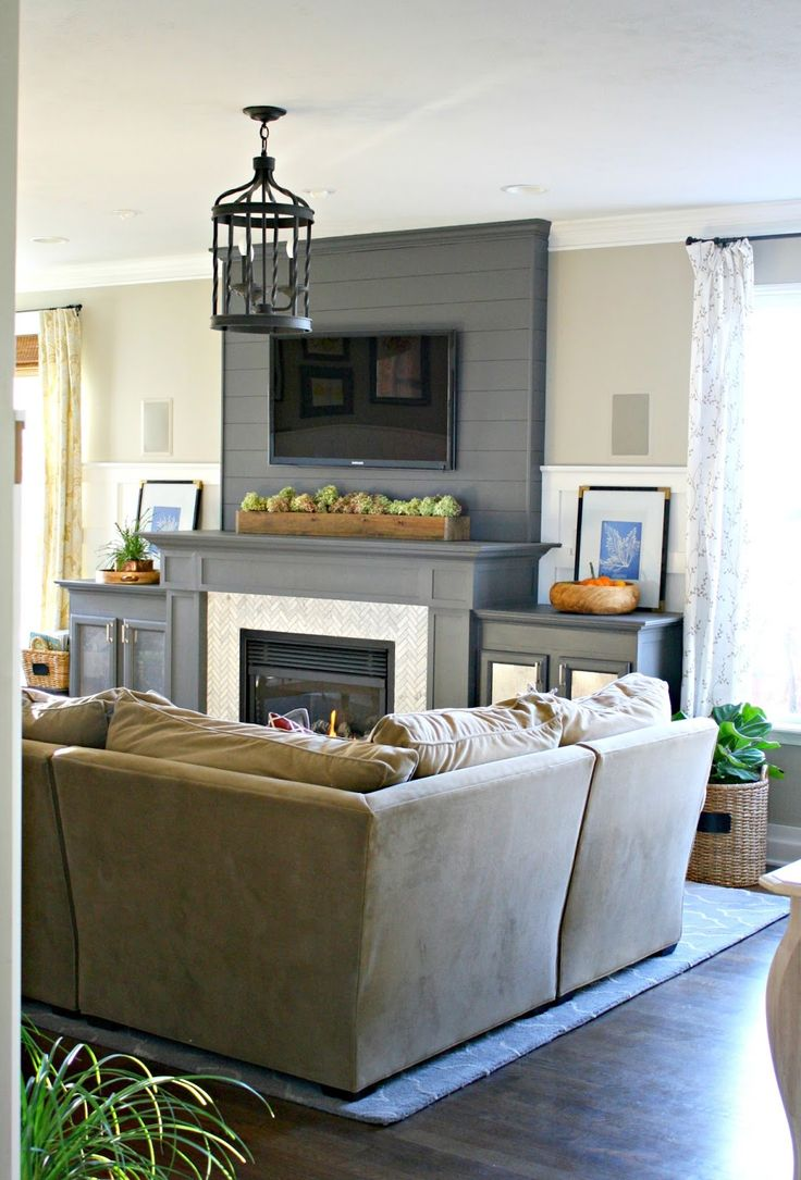 I'm in love with this fireplace wall........  Thrifty Decor Chick: Our Home