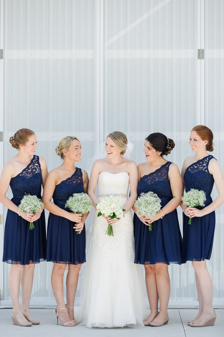Bridesmaids in Short Navy One-Shoulder Dresses | Photo: Ailyn La Torre Photography |