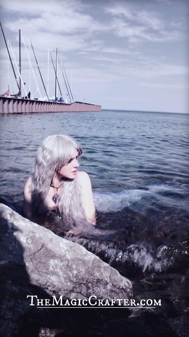 Mermaids are Real: CLICK to see video footage of a silver-haired mermaid caught on camera. She can be seen swimming up onto the rocks of a Northern Michigan shoreline. Apparently, it's not all that uncommon to see her  mermaiding in Lake Michigan. #mermaids #Professional #mermaid #Real #swimming