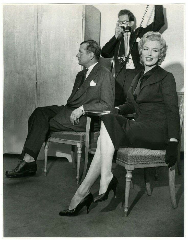Marilyn Monroe and Laurence Olivier at a press conference at the Savoy Hotel to announce the filming of The Prince and The Showgirl, 1956.