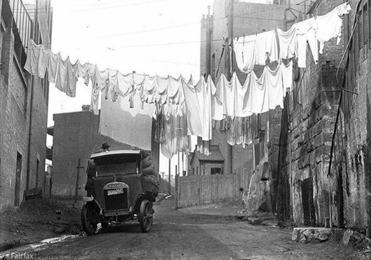 Washing hanging across Cambridge St,the Rocks in Sydney around the 1930s. •Fairfax Archives•