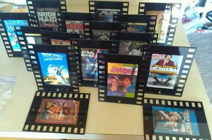 Instead of table numbers, we marked each table with a filmstrip frame filled with one of our favorite movies! After the wedding, we took the stands off and decorated our movie room with them!
