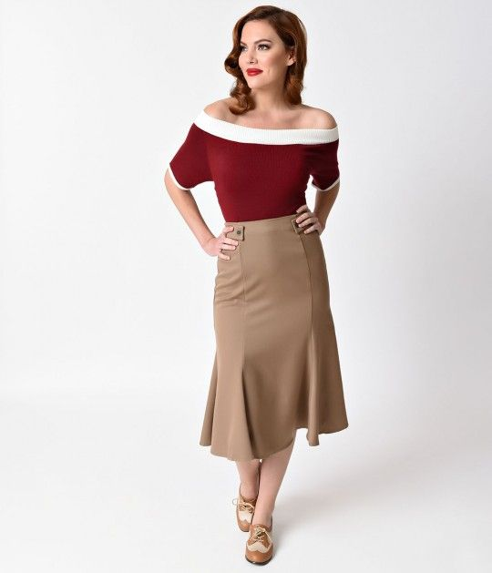 Act like a lady and dress like a boss, dames! A stunningly sculpted trumpet skirt from Banned, crafted in a soft woven blend, complete in a superbly 40s design! A fitted and flared seamed skirt is unlined with a hidden back zipper to help tuck you in and