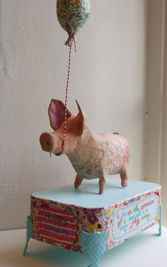 """Because what says """"happy"""" more than a pig with a balloon?"""