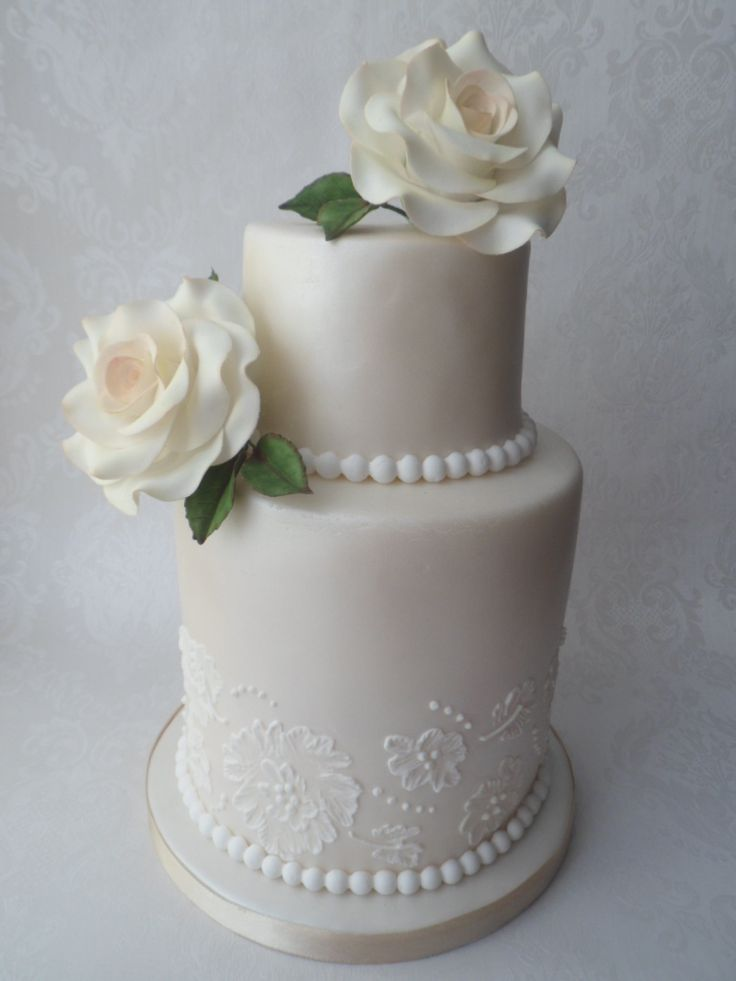 Two tier wedding cake, double bottom. With sugar roses, pearls and brush embroidery. Created by Carpel's Creative Cakes, from Essex