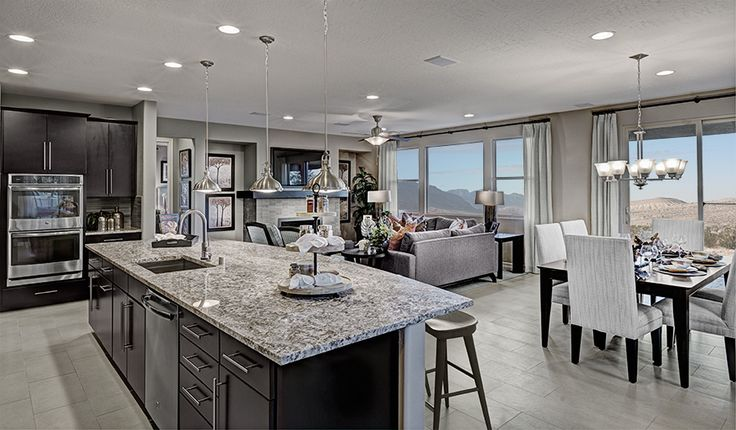 The new Henderson, NV, home is anchored by a bright, open kitchen with granite countertops and stainless-steel appliances| Rincon plan by Richmond American