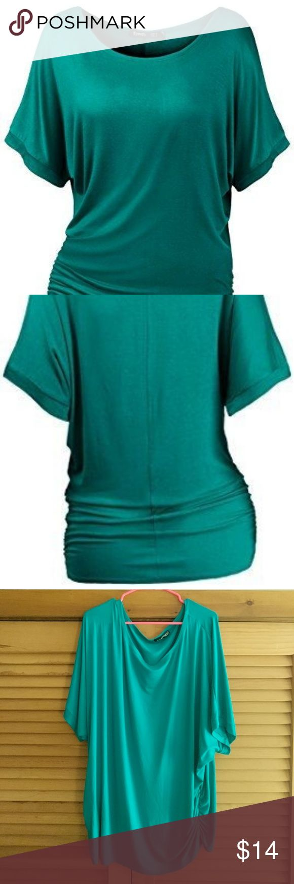 Plus size dolman drape tunic in jade green Gorgeous green top is super soft and lightweight. Has shirring on the sides, so you can wear it long like a tunic, or loosely ruche it around your waist and hips (disguises belly effectively!) Slouchy cut with a scooped back and kimono sleeves, it has great stretch and drape. I love this brand and have TONS of their tops!! NWOT, has never been worn. Thanth Tops Tunics