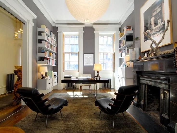 Julianne Moore's home office.  I like the bookcases with the ends on them.  Open, yet the books aren't going to slide off when the kids rumble past.
