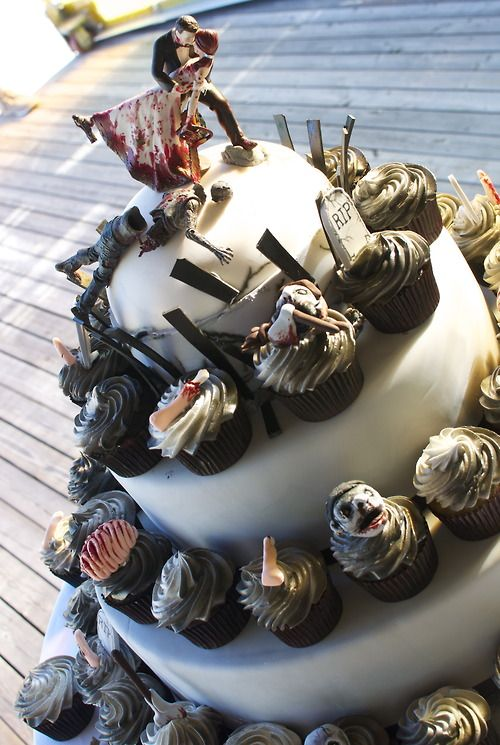 zombie wedding cake--awesome. Too bad I'm already married...with a cake not nearly that cool!