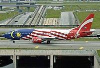 AirAsia (MY) Boeing 737-301 9M-AAI aircraft, with ''Malaysian flag'' livery, skating at Malaysia Kuala Lumpur Sepang International Airport. 25/11/2005.