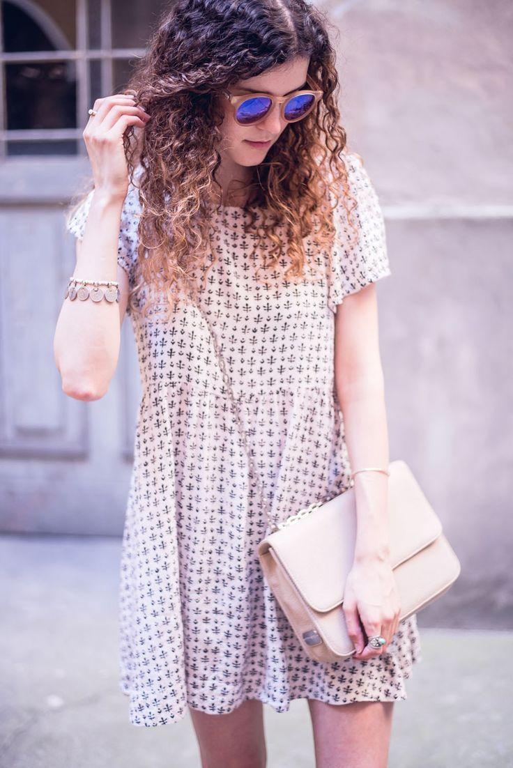 vintage dress and vegan handbag