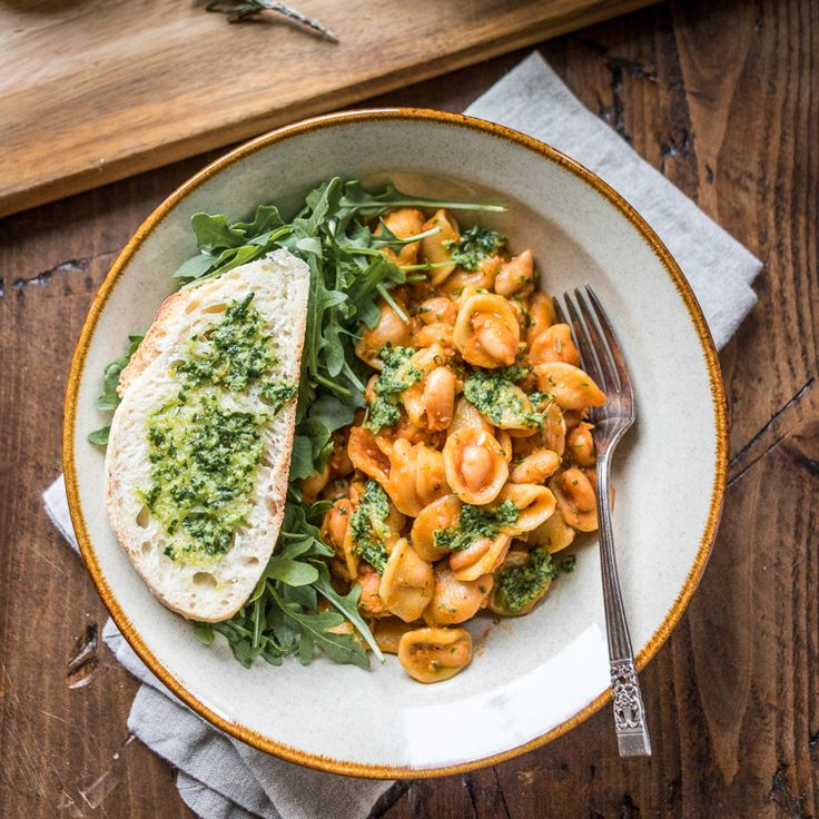 Tender beans cozy up with hearty pasta and fragrant pesto in this easy thirty-minute meal. White beans and pasta is sure to become a family favorite!