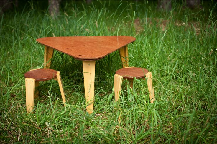 Hebe's wooden Triangular Table.  Available with a varnish top and height options of 450mm or 500mm sides 950mm. Available online at www.hebe.kiwi.nz