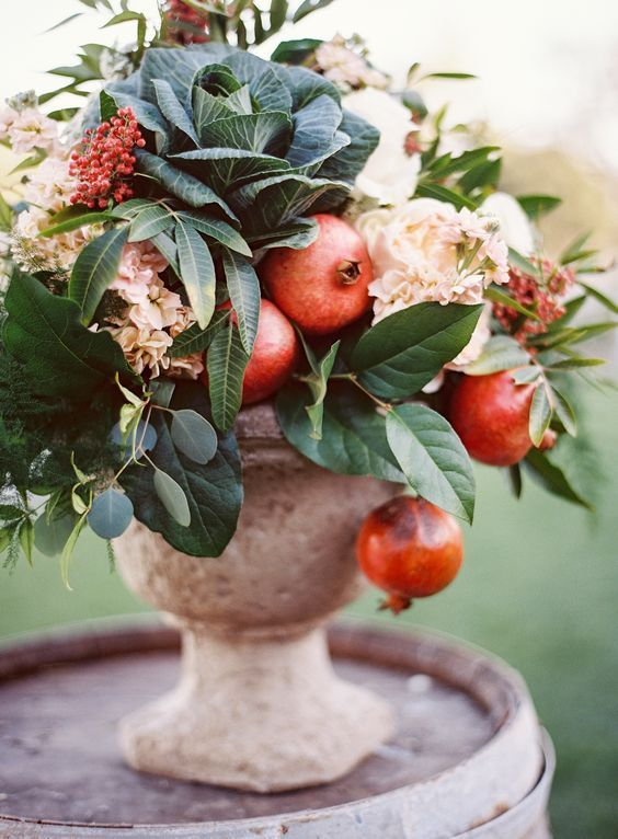 12 Yummy-Looking Wedding Centerpieces With Fruits And Vegetables: a fall wedding centerpiece with leaves, berries, hydrangeas, cabbages and pomegranates for an organic celebration
