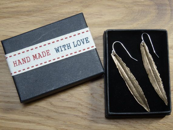 A fabulous pair of bronze, real olive leaf, long drop earrings.   The bronze dangle earrings are hung on sterling silver wires.  These inspired by #nature handmade dangle an... #naturelover #style #trend #hmuk #hypoallergenic #peace