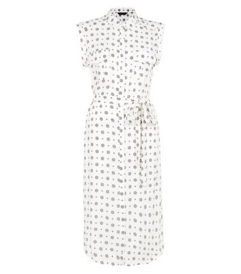 """For summery work-wear styles try this tile print midi shirt dress with block heel sandals.- All over tile print- Sleeveless design- Button front fastening- Pocket front- Tie waist- Sleeveless design- Midi length- Model is 5'8""""/176cm and wears UK 10/EU 38/US 6"""
