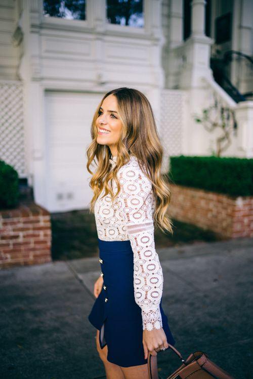 High waist navy skirt with a lazer-cut white blouse