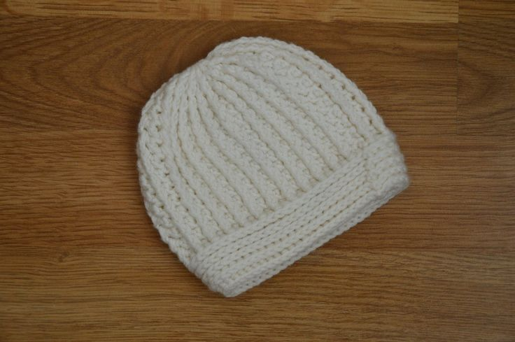 Crochet newborn hat from virgin merino wool.