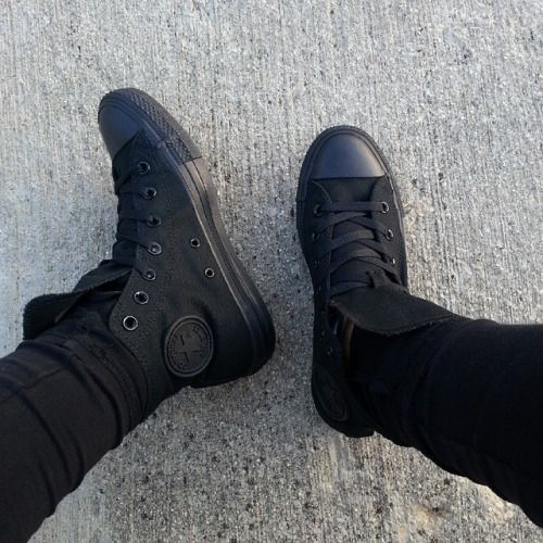 all black converse on