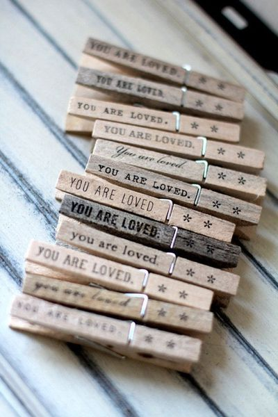 'You are loved' clothes pins. Would love to make these to clip pictures of loved ones to a cute cord/rope across my wall