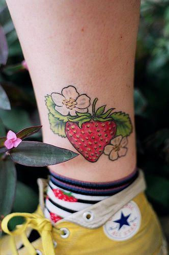 Strawberry tattoo.
