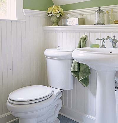 Beadboard wainscoting and period fixtures define this classic half-bath. | Photo: Andrew Bordwin | thisoldhouse.com