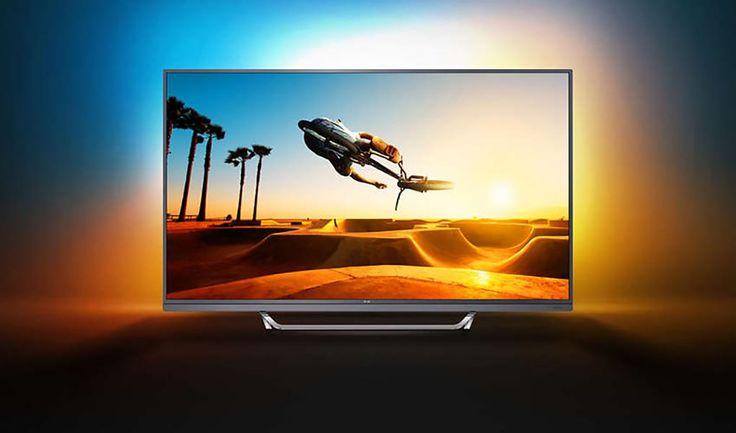 """Philips 49PUS7502  Description: Philips 49PUS7502/12: 49"""" 4K UHD TV De Philips 49PUS7502/12 is een TV die dankzij de 4K UHD kwaliteit prachtige beelden laat zien. Geniet van intense kleuren niet alleen op het beeldscherm maar ook rondom de TV dankzij Ambilight. Dankzij een geïntegreerde SoundBar met woofer heb je prachtig geluid en wordt jouw filmbeleving nog intenser. Als er een keertje niets op de TV is schakel je snel over op de Smart Hub en kies je uit de content jouw favoriete film of…"""