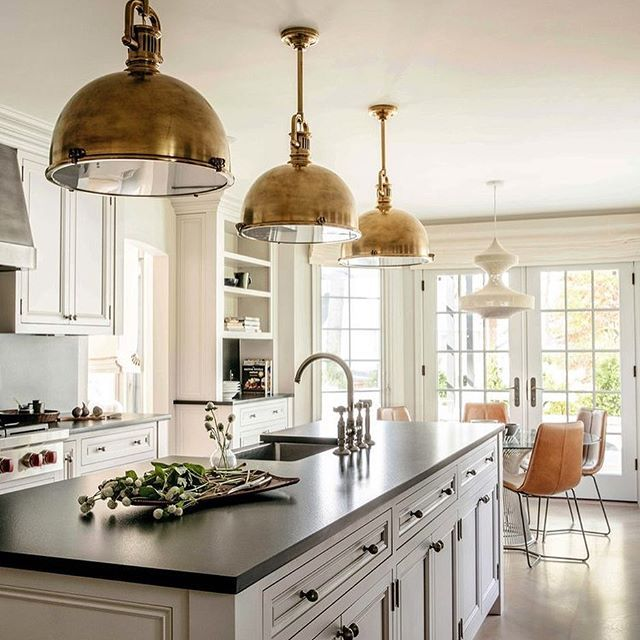 Mixed metals looking stunning in this kitchen designed by @rcstudio_ That statement lighting isn't too shabby, either | @scoutandnimble Instagram