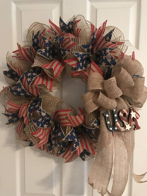 Show your patriotic pride on the Fourth of July, Memorial Day, Veterans Day, Presidents Day, Labor Day, or anytime of the year.  This wreath is made of poly burlap deco mesh. It is then accented with burlap stripes ribbon and burlap stars ribbon. An open weave burlap bow attached with a rustic wooden USA sign. The wreath measures approximately 24 inches wide and 29 inches long which includes the bow tails. Ready for immediate shipment. Thanks for visiting RoesWreaths