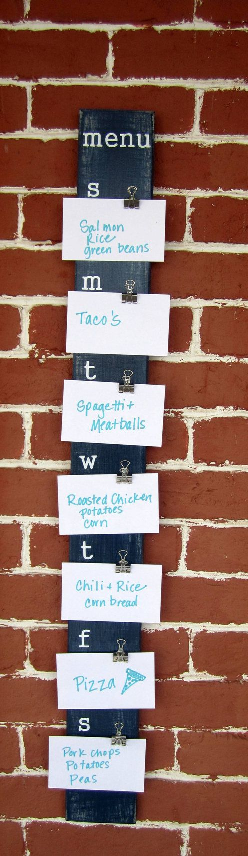 "Could totally make this. You could write the recipes on the back and just keep them stored in a small box.Weekly Planning Menu Board - 3.75"" x 36.5"" - Using index cards rather than chalkboard paint. No need to wipe down if you need to rearrange a meal! Genius."
