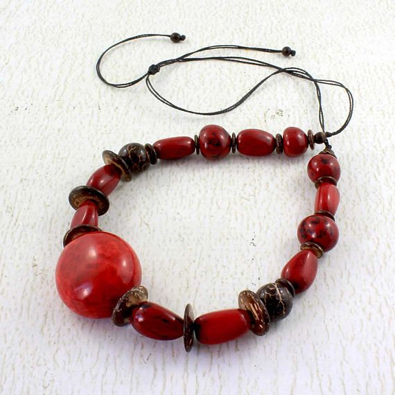 This vivid red tagua necklace with coconut will bring a pop of luscious color to a casual outfit. Tagua nut jewelry is made with chunky nuts from the Amazon Rainforest in Ecuador. To make this eco friendly jewelry, the organic material has been dried in the sun. This red statement