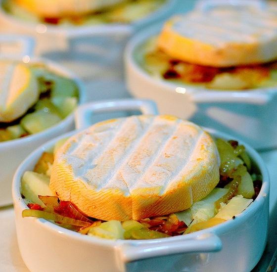 """Tartiflette   4 -6 large potatoes,  2 large onions, a handful of sliced champignons de Paris, a packet of bacon pieces, Reblochon chees, créme fraiche (optional), paprika or """"piment d'Espelette""""; for serving: slices of smoked ham, fresh green salad, vinaigrette."""