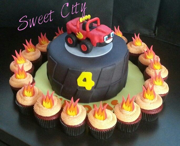 Wow, we love this Blaze Monster Machine cake and flame cupcakes combo by SweetCity Vallarta!