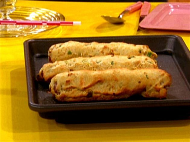 Get this all-star, easy-to-follow Oven Baked Corn Dogs recipe from Rachael Ray