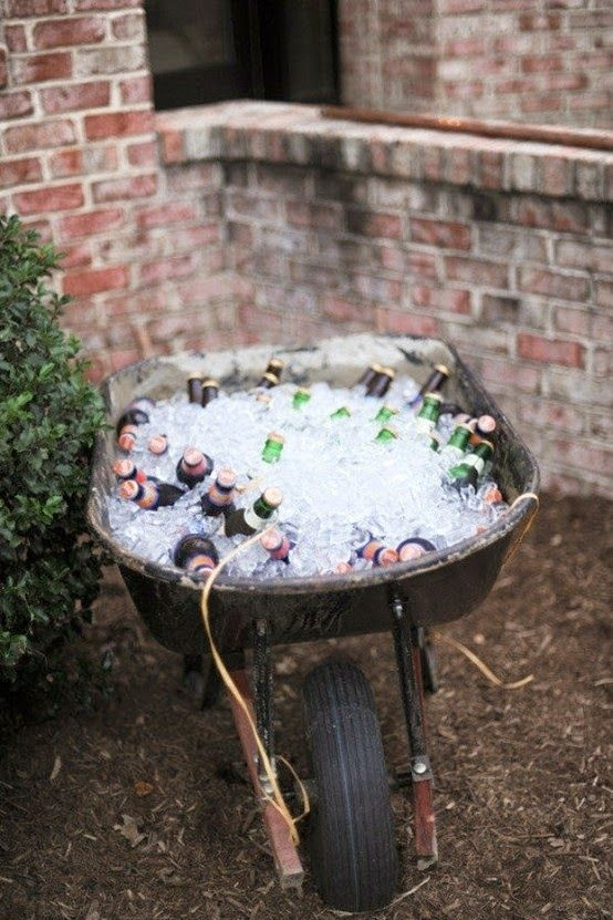 Rustic style of serving beverages in an old wheel barrow.