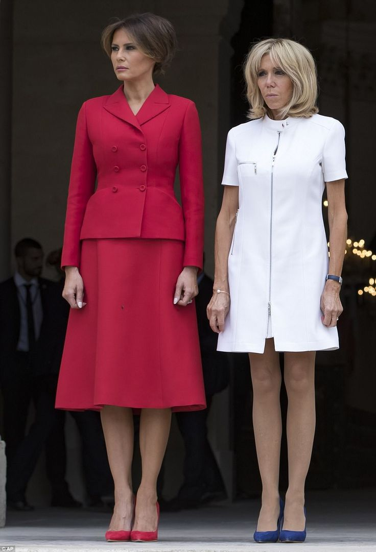 Melania looked every bit the first lady in a cheery red skirt suit, while Brigitte donned ...
