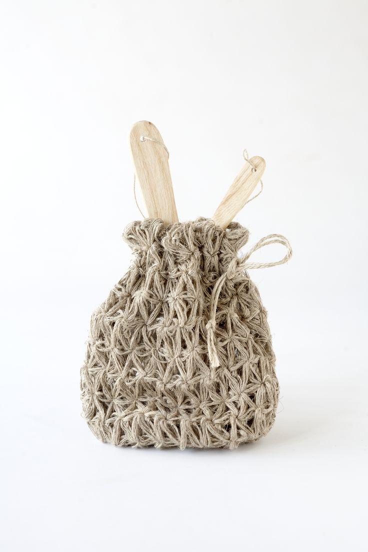 Artzuma's wooden handled pumice stones for hand and feet will revitalise tired skin and come in a hand-crocheted jute bag.