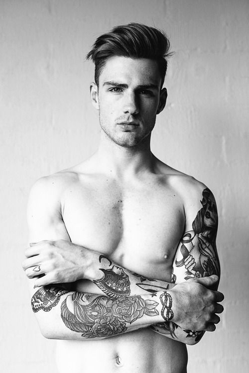 Thomas Davenport,actually I focus on his hairstyle more than his face and tatoo.